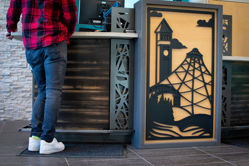 This dimensional silhouette shows off two of Spokane Washington's most well loved attractions – the Clock Tower and the Pavilion right next to the river.
