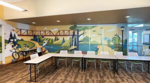 Mural with cyclists, historical bridge and local wetlands illustration